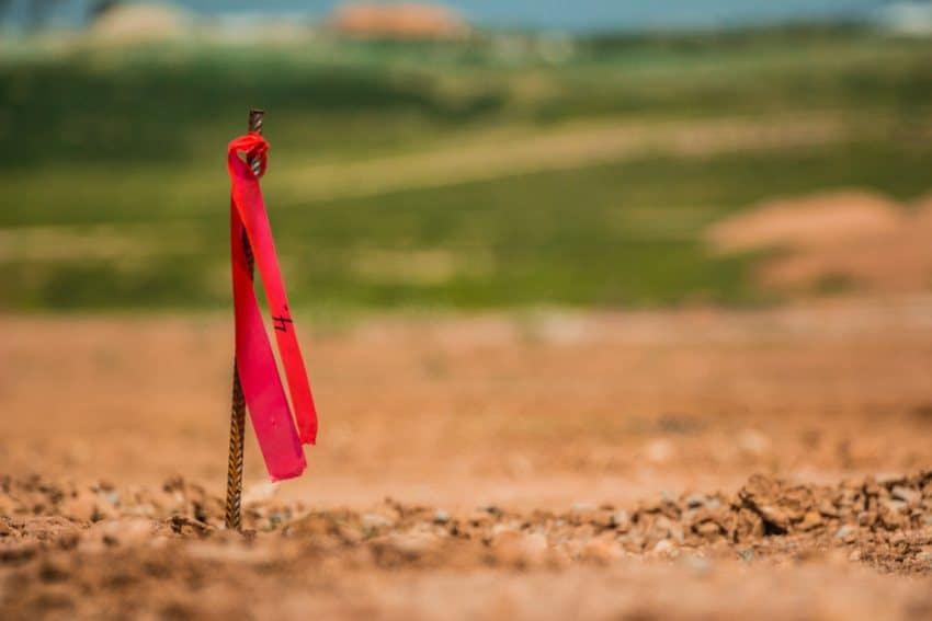 can you use a metal detector to find property stakes